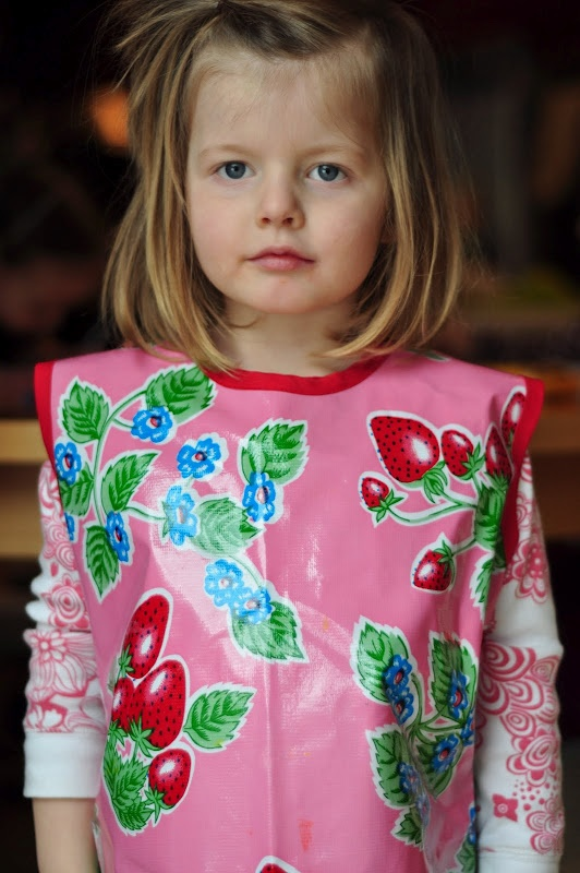 Art Smock pattern using oilcloth.  this tutorial has wonderful links to fabric and notion sites