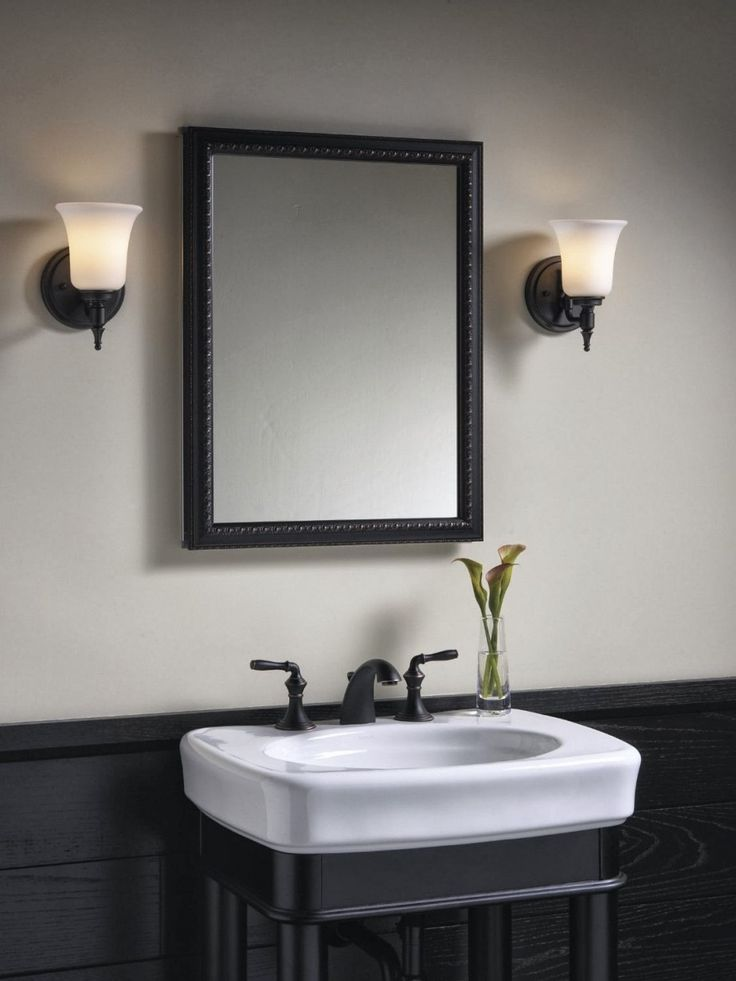 Pedestal Sink And Double Handle Brushed Bronze Sink Faucet.