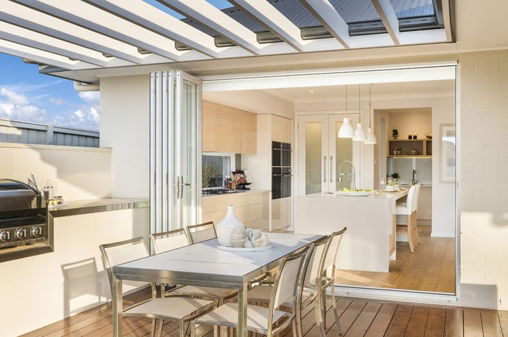 Spectacular indoor/outdoor living on the #alfresco through #bifolddoors. What do you think? This is the living hub in our Miami 16 on display at HomeWorld South, Gledswood Hills - http://mcdonaldjoneshomes.com.au/display-home-locations/homeworld-south-gledswood-hills. #kitchen #islandbench #barstools #alfresco #bbq #verendah #deck #outdoorentertaining #outdoor #nature #environment