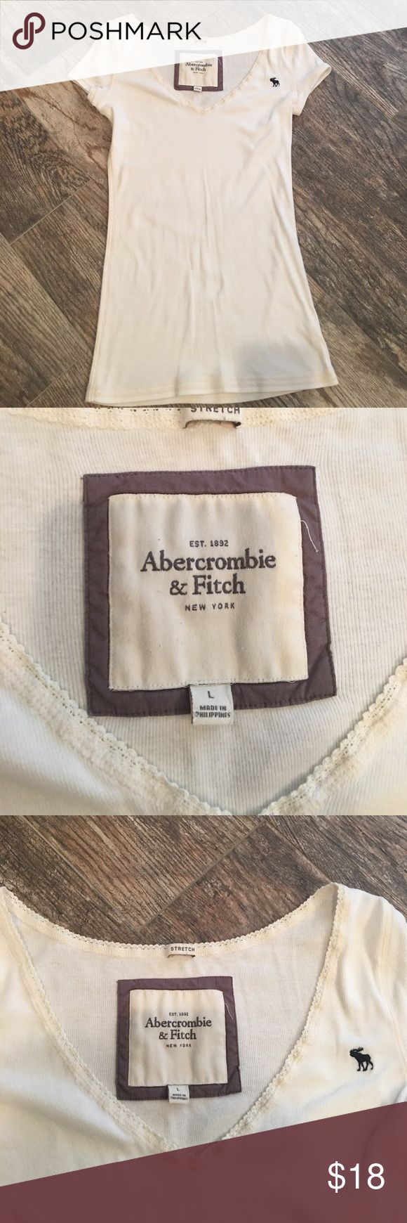 Abercrombie and Fitch casual top Abercrombie and Fitch casual knit top. White with cream stitching and lace at neck. Size large (runs small) excellent condition. Clean smoke free home Abercrombie & Fitch Tops Tees - Short Sleeve