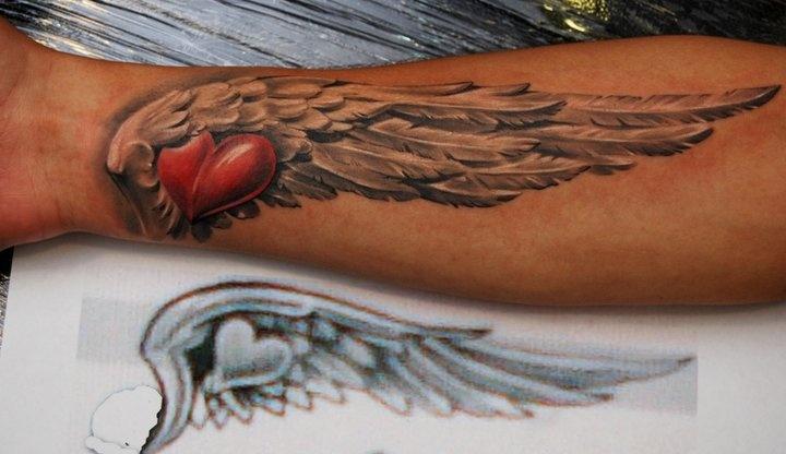 Dmitriy samohin tattoo wings heart tattoo mostly for Wing forearm tattoo