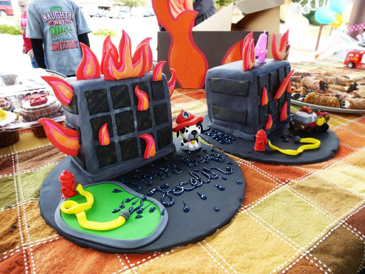 Burning buildings firefighter birthday cakes  the firetruck is clay i made for a christmas ornament
