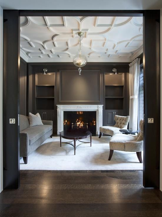 Things We Love: Pocket Doors - love the contrast of the dark wood and the neutral decor - beautiful molding on the ceiling