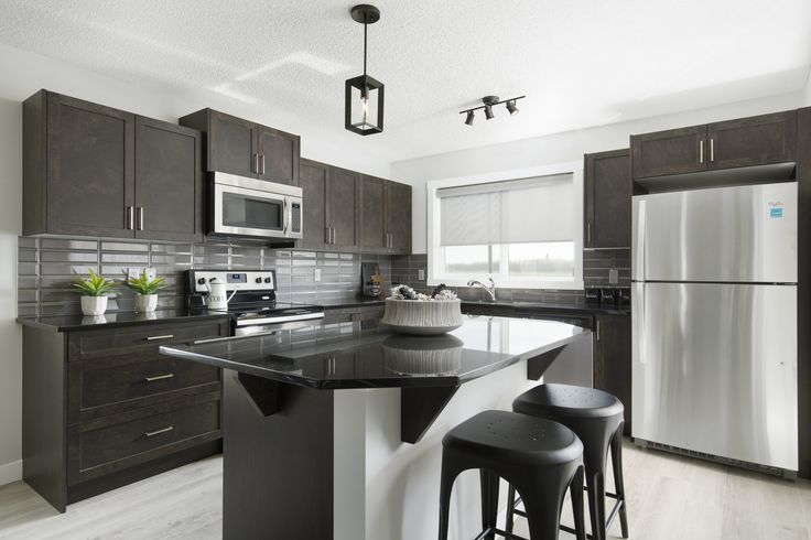 Kitchen in Creations by Shane Homes Arbor Duplex Showhome in Legacy in southeast Calgary #kitchen