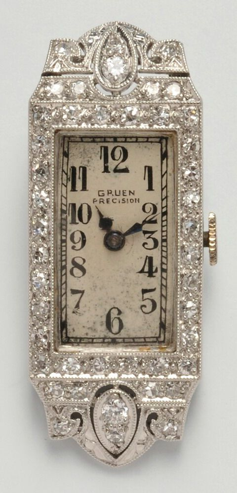 Art Deco Lady's Platinum and Diamond Wristwatch, Gruen, the ivory-tone dial with Arabic numeral indicators, manual-wind 17-jewel movement, the case set with transitional- and old single-cut diamonds, millegrain accents, 37 mm, signed.