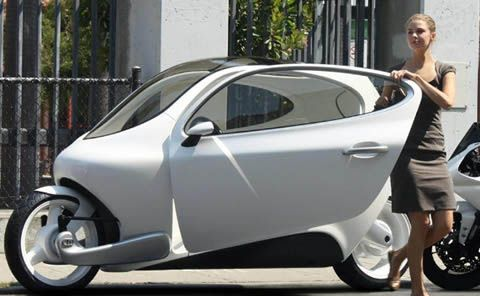 Shrinking the American car - San Francisco's Lit Motors and the C1 electric automotocycle - getting more people around the city in independent vehicles, the way Americans prefer [Now, you can do it in a dress and in the rain - cycle that is.] one-seater with a place for groceries.