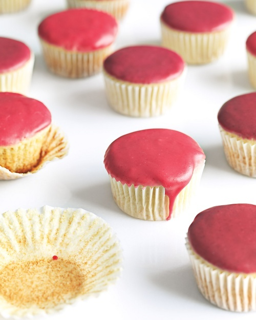 Vanilla Cupcakes with Fruit Glaze Recipe -- pitted cherries and raspberries used for the glaze, but other fruits work, too.