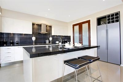 caesarstone jet black bench top with white cupboards and