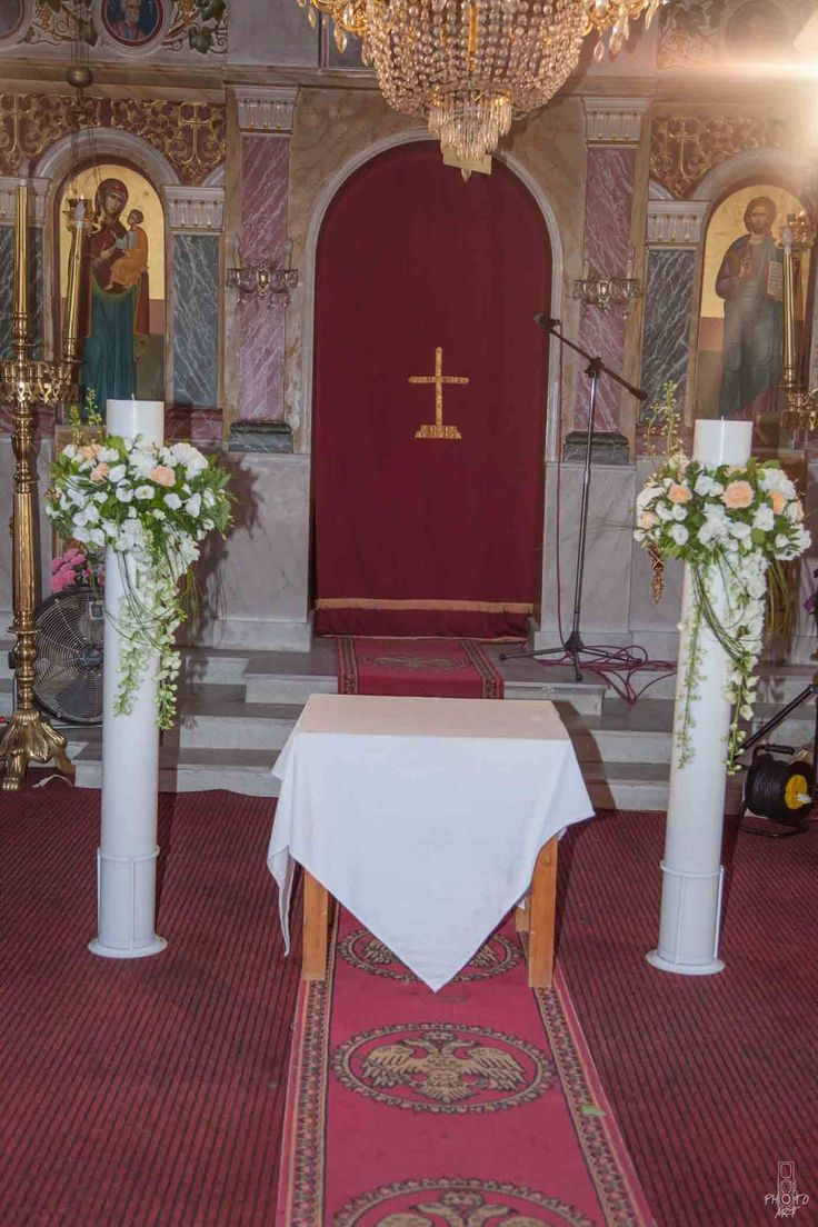 Orthodox church wedding, lampathes with orange and white flowers