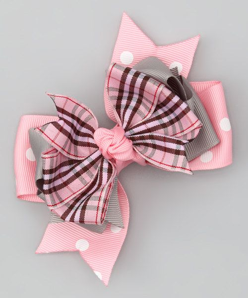 If there's anything sweeter than this beautiful bow, we don't know what it is! Artistically styled layers, classic plaid and perky polka dots combine for one seriously fabulous addition to any little darling's 'do. Grosgrain ribbon / alligator clipImported