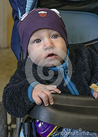 Little baby in carriage , boy , the younger than one year old.