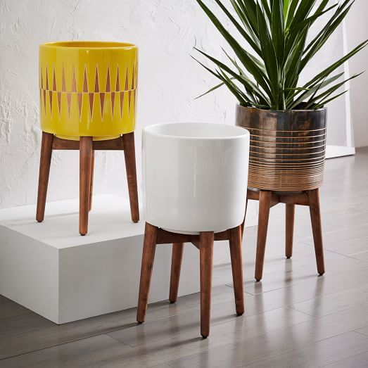 Mid-Century Turned Leg Planters | west elm, solid wood legs in Walnut, solid ceramic planter, $129-$169