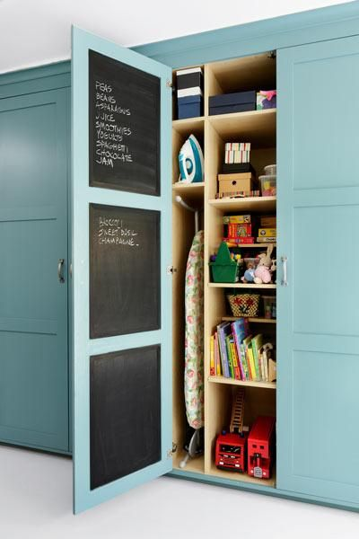 Create a hidden memo board inside a pantry door for a handy place to record your grocery list and calendar. All it requires is a few coats of chalkboard paint. | Photo: David Still/Beautiful Kitchens/IPC + Syndication | thisoldhouse.com