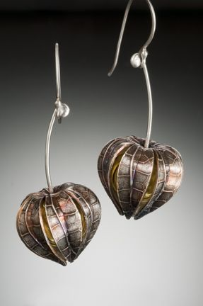 "Maine jewelry artist Nisa Smiley's lovely ""Physalis Earrings."" Fine silver metal clay, sterling silver, hand blown hollow glass bead (interior)."
