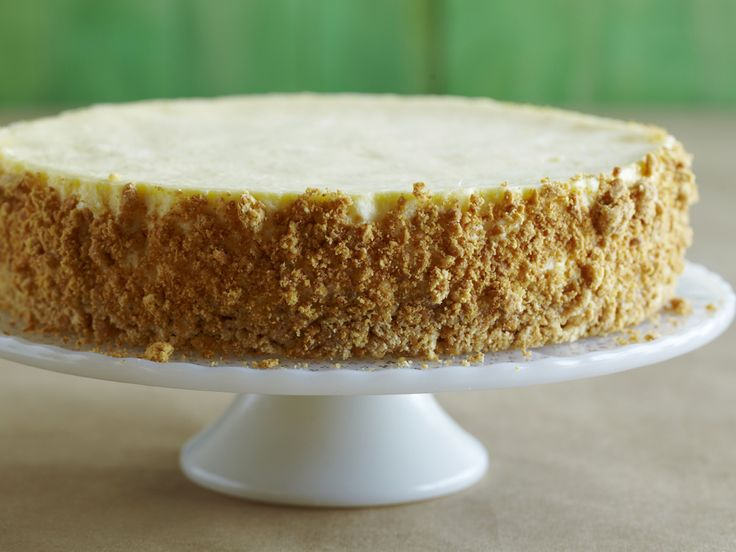 Easy homemade cheese cake with graham cracker crust! All real ingredients! Graham crackers, butter, sugar (only 1 cup in the whole cake), cream cheese, sour cream, eggs and heavy cream. Done in 2 1/2 hours!!!!! Can't wait to make this!