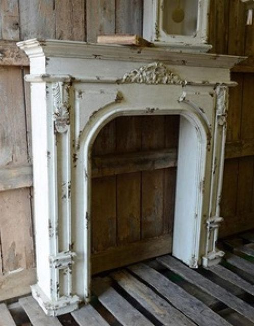 Farmhouse Style - faux fireplace! This is my favorite!!! I want to make one just like this!! Well you can, using matched pairs of wood corbels from Wild Goose Carvings and an onlay centerpiece. See their full range of fireplace components, including fire surround kits, at www.buycarvings.com