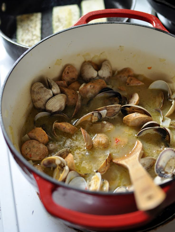 Use garlic, spicy sausage, and wine to make these clams.