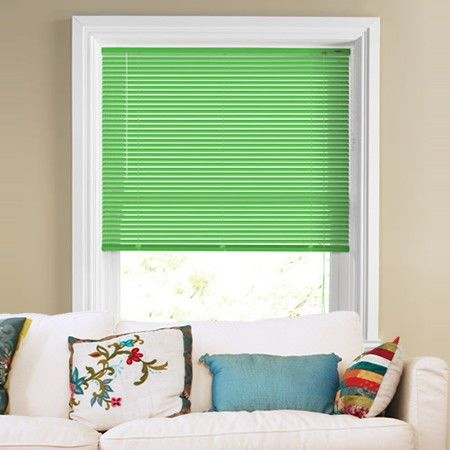 Metallic and glossy, this bright Venetian Blind looks great with the contrasting white sofa.  #home decor #green Venetian blinds #247