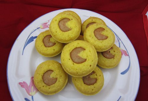 Pacman Pac-dots - Mini corndog muffins with a hot dog Pac-man center.
