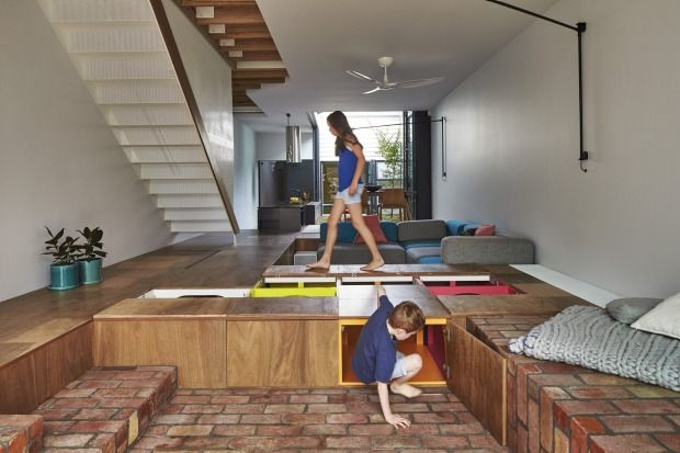 Toy room: Austin Maynard Architects' house in Middle Park creates storage space in the raised wooden floor.
