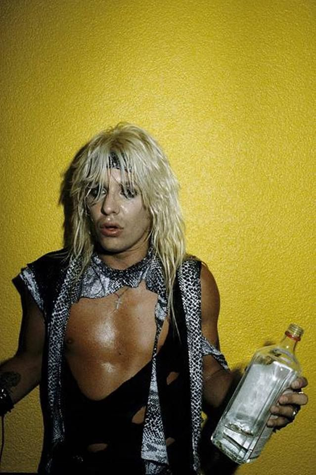 Vince Neil  What'cha drinkin' sexy man? Is that Vodka? I can't drink that stuff, it burns my throat. I guess I'm allergic to it. I prefer Wine or Wine coolers. D