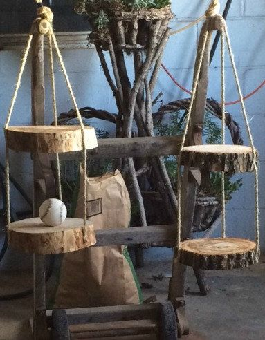 Each shelf unit has 2 log slices connected with 3 rustic style ropes. The slices…
