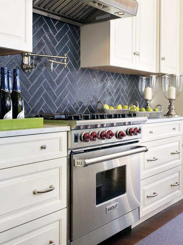 Kitchen; stove; counter; herringbone pattern backsplash | Interior Designer: Susan Anthony / Image source: HGTV