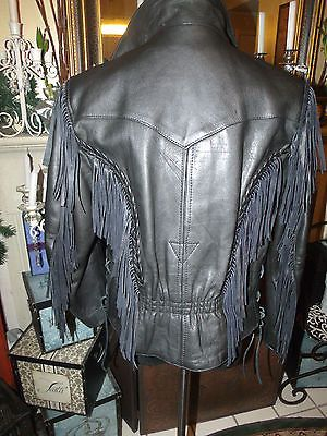 Men's black leather jacket braid fringe side lace up detail motorcycle see measurementsarmpit to armpit 20 in length - 23 shoulder width - 17 in sleeve length- 23 this is a very nice detail jacket. Has braiding detail with fringes in front and back.back side has pleat detail and sides of the jacket are laced. Sleeves have zipper inside the jacket looks to be missing a zip out liner and has deep side pockets on both side of the inner part of the jacket for added storage. Froo www.froo.com ...