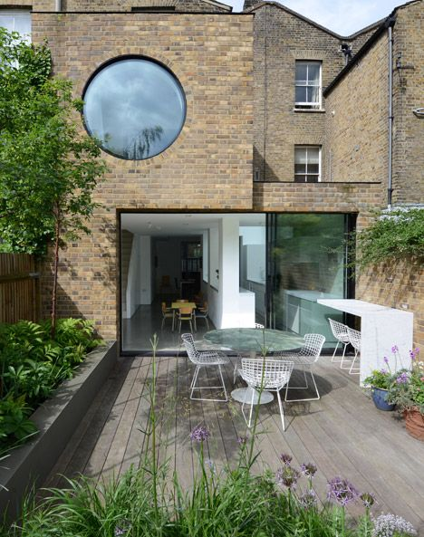 Jimi House by Paul Archer Design features round window inspired by abstract art.