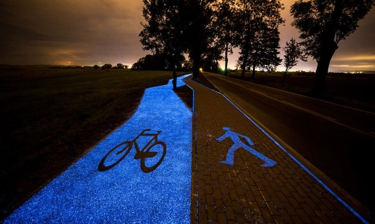 A glowing blue bike lane designed by TPA Instytut Badań Technicznych Sp. z o.o. opened recently in Poland close to Lidzbark Warminski.