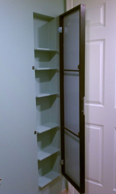 Cabinet built into bathroom wall. 5in deep shelves. Behind door. (Or where hamper currently is?)