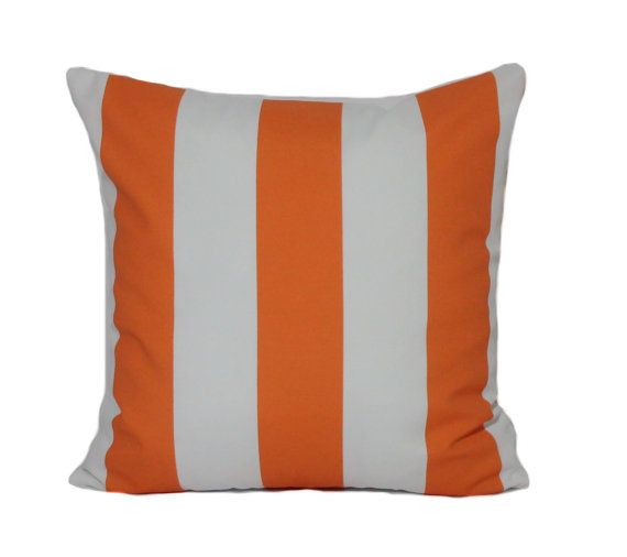 Our orange and white stripe outdoor pillow cover makes a fun accent piece for Halloween!  The pillow insert is not included.  Features of this outdoor pillow cover include:  ***Same fabric front and back ***Made from 100% polyester ***The stripes are 3.25 inches wide. ***Includes an invisible YKK zipper at the bottom for a professional finish. Display your pillow from either side! ***All seams are over-locked to prevent fraying. ***All stress points are reinforced for added durability…