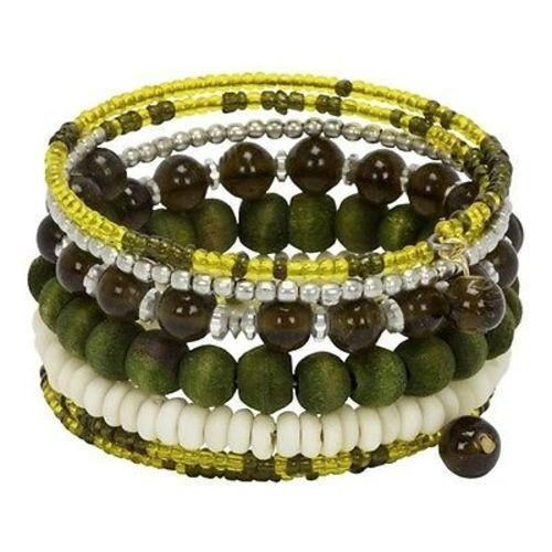 Each turn of this bracelet sets off the next. From glass to metal to wood to bone, the beads strung on seven turns of wire create a stunning piece of jewelry. 3 inches in diameter by 1.25 inches tall.