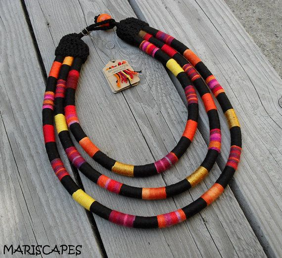 Gorgeous tribal-inspired yarn-wrapped rope necklace meticulously created with mixture of various colorful yarns! You can be sure that your necklace