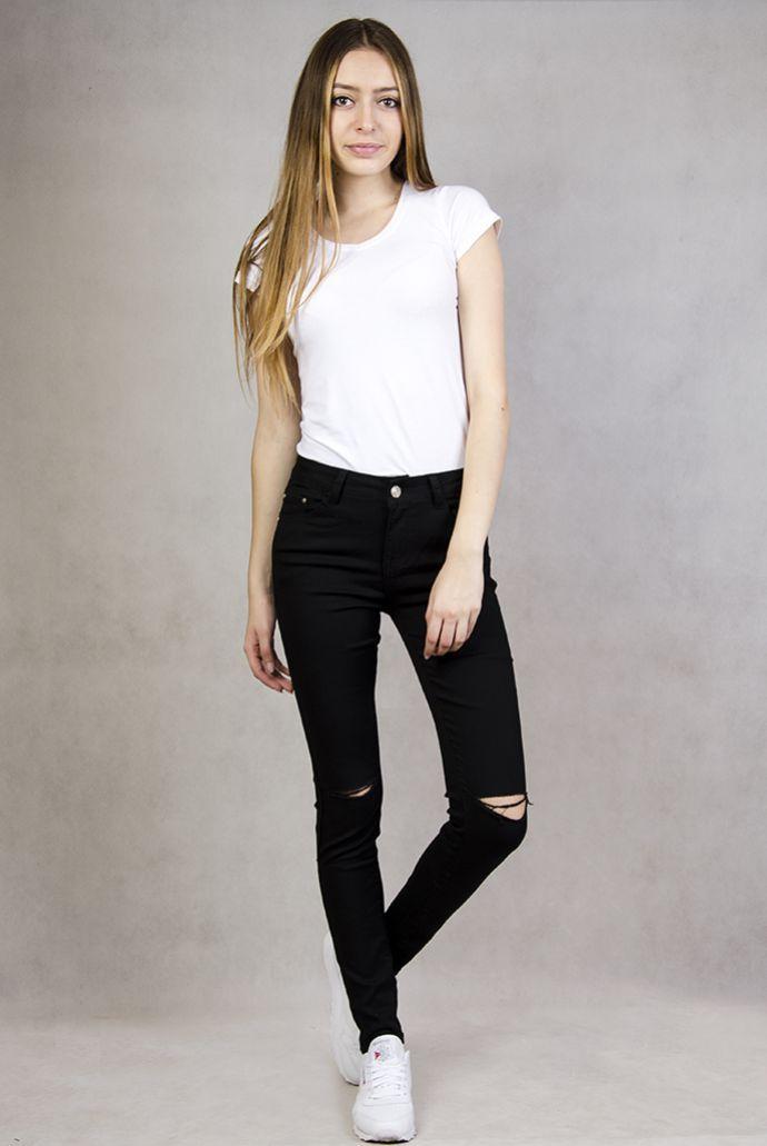 Czarne spodnie jeansowe rurki z dziurami