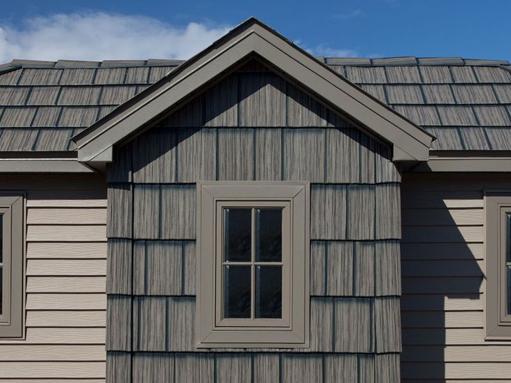 This dark gray-brown steel roof from Arrowline has the look of genuine wood shakes.  We like how the roofing is also installed on the front of the gable - a nice complement to the tan siding.  For #MetalRoofing in Minneapolis MN, contact us - http://www.quarve.com