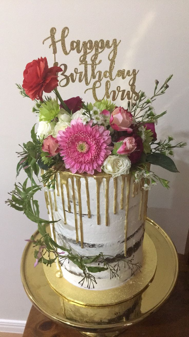Double barrel 7 inch mud cakes with gold drip and seasonal flowers