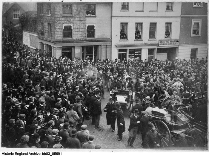 BB83/05691 Large crowds greeting the arrival of motor cars into the Market Place, Reigate at 1.00pm. The cars were taking part in the first London to Brighton Emancipation Run to celebrate the passing into law of the Locomotives on the Highway Act. 14 Nov 1896 Please click for more information or to search our collections.