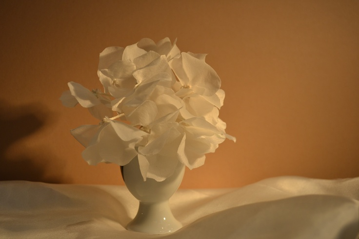 Silk satin hydrangea.  Eleven individual flowers with silk knot centres.