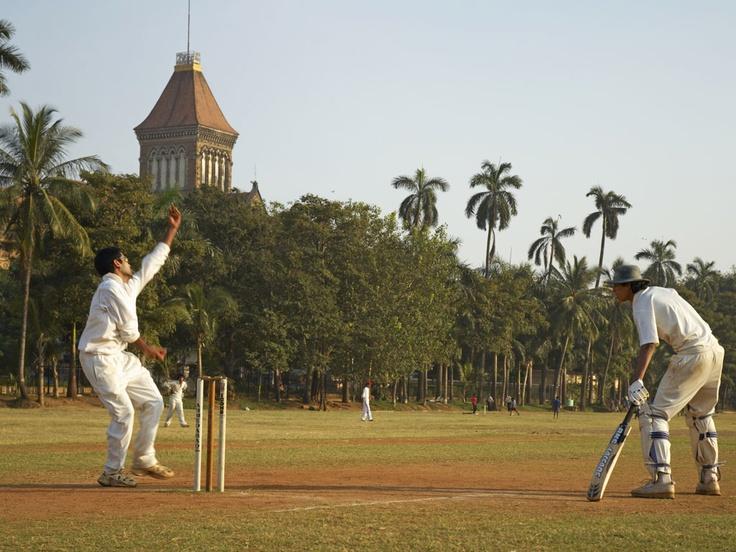 Cricket on Oval Maidan; Mumbai University in background.