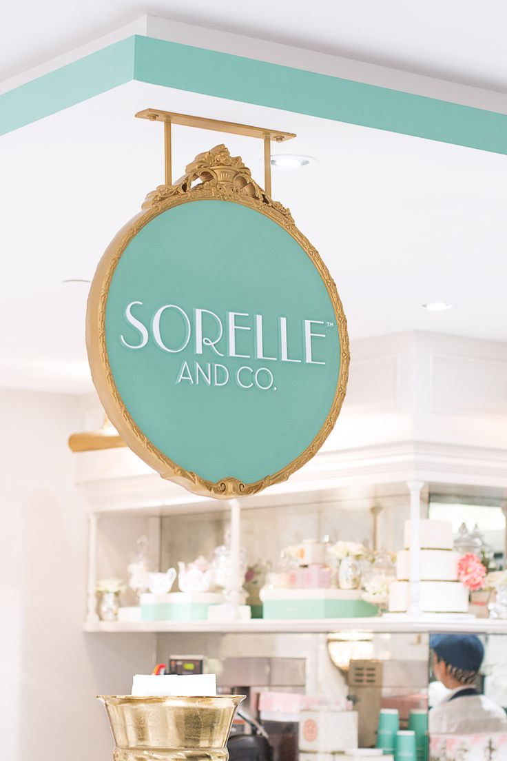 Signage at Sorelle and Co.'s Saks Food Hall by Pusateri's location in Toronto