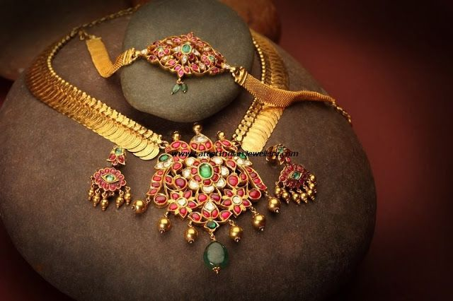Brilliant Design of Traditional Kasu Mala with Ruby Pendant Paired with matching Earrings and Arm Band