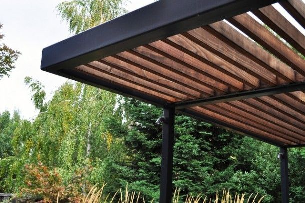 Exterior - Awesome Wood Pergola Design With Iron Pillars In The Back Yard Area With Green Lust Trees: Modern Pergola Design Ideas for Your M...