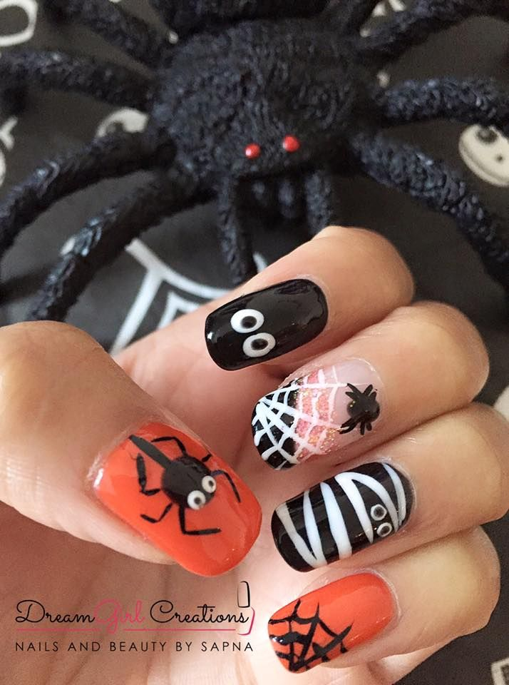 Sapna Sheth has created these great #halloween #nails using #CND™ #SHELLAC® & #Lecente #glitter and #Lecente #brushes #lovelecente #halloweennails #spidernails #spookynails #orange #orangenails #black #blacknails #cobweb #cobwebnails #nailinspo
