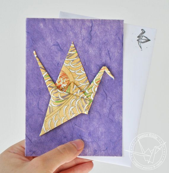 Introducing new origami greeting cards at the Teeny Folds shop on Etsy. These handmade cards are blank on the inside, making it perfect for any greeting, any occasion. This beautiful card is a red peace crane on rich purple card. #etsy #origami #crane #stationery #handmade #cards
