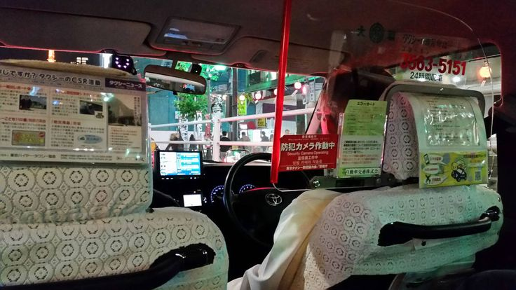 Toyota Crown taxi driver in Tokyo