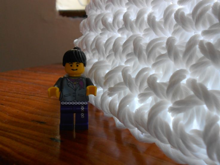 White plastic rope basket, crocheted, with lego lady for scale