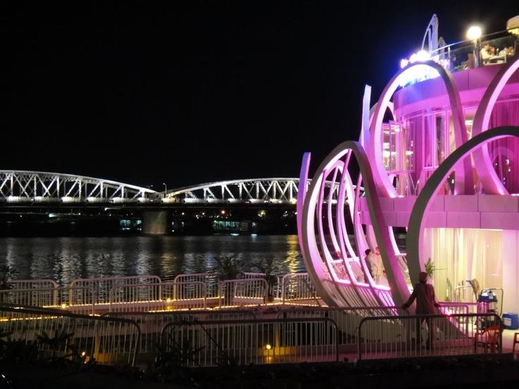 Restaurant & bridge on the Perfume River at night, Hue City, Vietnam