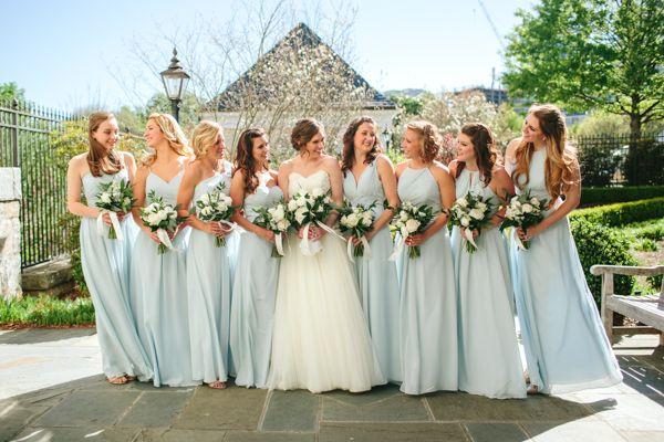 ivory wedding dress and light blue bridesmaids dresses