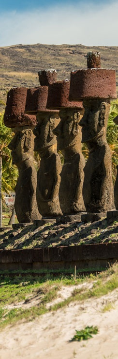 This group of #Moai statues at Anakena Beach on Easter Island still retain their topknots. These statues are in a better than average condition because they were protected by a covering of wind-blown sand until they were restored and placed back upright again. #easterisland #isladepascua
